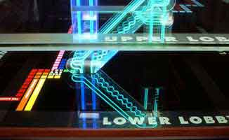 Zoom on a architectural signage, in colored neon, elegantly reproducing the 3-D structure of a building | CRA Design