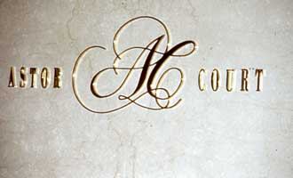 Signage in gold letter part of St. Regis Sheraton Hotel branding and visual identity | CRA Graphic Design