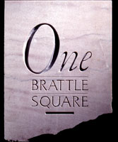 The architectural signage is a Carved stone fallowing One Brattle Square Logo | CRA design