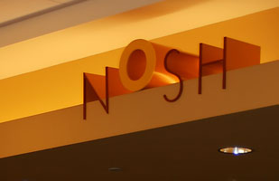 the Architectural signage based on the logo is part of Nosh' restaurant branding and visual identity | Coco Raynes Associates, Inc.