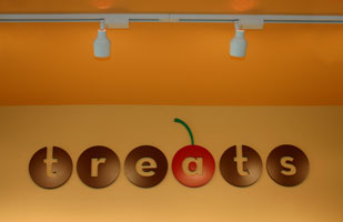the Architectural signage based on the logo is part of Treats' restaurant branding and visual identity | Coco Raynes Associates, Inc.